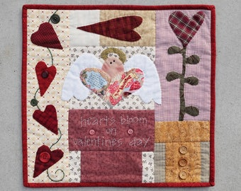 Quilted Valentin's Day table topper or wall hanging.