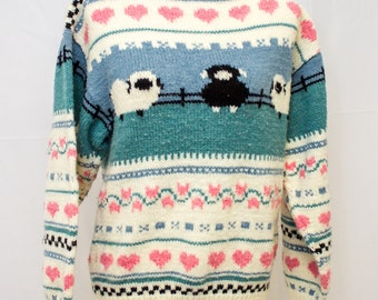 Hand knit Sweater with adorable sheep and heart pattern.
