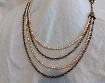 Freshwater pearls and antique copper chain.