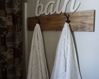 Rustic wood with iron towel hooks