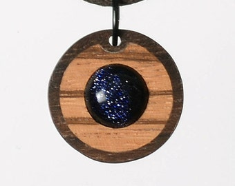 Goldstone with zebrawood and walnut burl. Glass jewelry combined with fine wood. Handcrafted in Germany. Cool idea, isn't it?