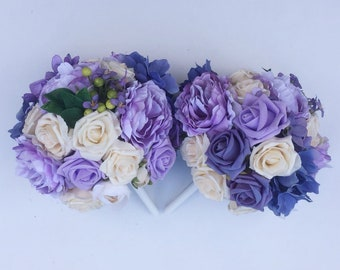 Lilac purple and ivory wedding flower bouquets - perfect for brides or bridesmaids
