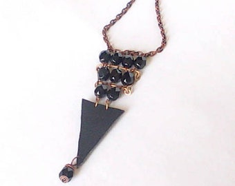 Long necklace with triangular leather insert and black glass beads, black minimalist necklace, gift for her