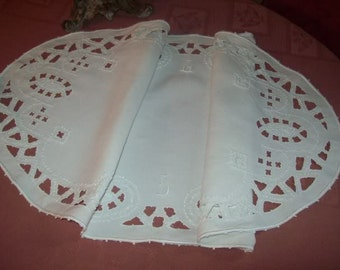 A vintage table runner in white linen hand embroidered, French lace doily