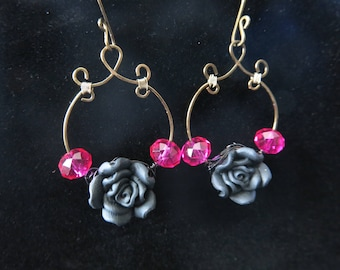 Black rose and bright pink beaded wire earrings.