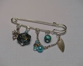 Brooch with blue pendants