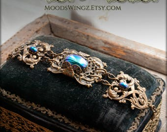 The Supreme Goddess - Peacocks and Paisley bracelet. Peacock blue eyes are the glorious essence of this antique brass filigree bracelet