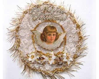 A cherub Angel on vintage cotton crochet lace doily with tinsel details and lilies Christmas decorations or wall hanging recycled