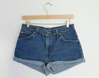 Vintage Levi's Medium/Dark Blue Wash High Waisted Rise Cut Offs Cuffed Rolled Denim Jean Shorts 28