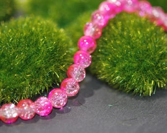 set of 10 glass beads, clear and bright pink