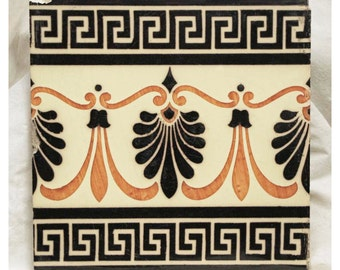Orange and black geometric tile