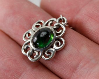 Spiral pendant with oval green tourmaline cabachon