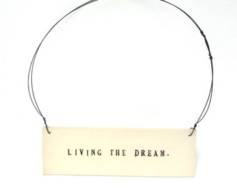 living the dream  ...   inspiring tag   ...   hanging porcelain sign