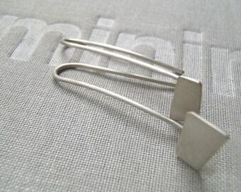 Silhouettes sterling hook earrings in brushed black or silver.