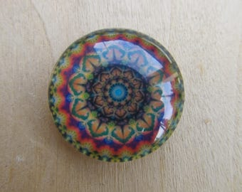 Glass cabochon round 25 mm in diameter with background scenery kaleidoscope image.