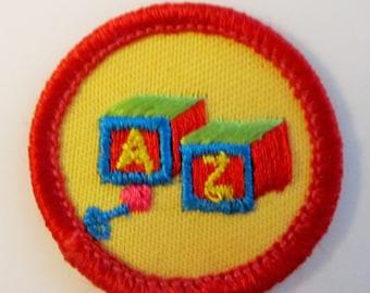 "Vintage Junior Girl Scout Badge ""Caring For Children"" circa 1990"