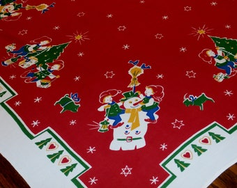"Cute 1960s Vintage Cotton Christmas Tablecloth Table Topper 33 1/2"" x 30"" Children, Trees, Snowmen, Stars"