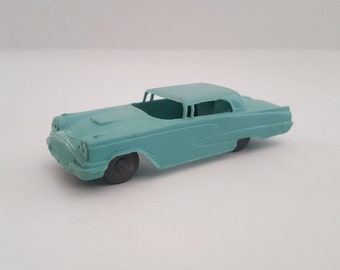 Vintage 1960 Ford Thunderbird plastic toy car, unmarked, turquoise color with gray wheels