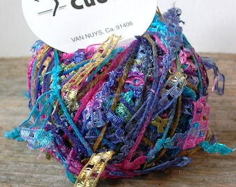 trendsetter cubetti . carnival 1056 . novelty ribbon flag art yarn . 75yd . turquoise blue pink gold checked ladder flags discontinued yarn