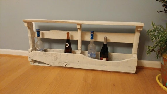 White washed wine rack for wall.  Made from pallet wood