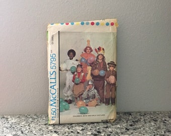 Children's costumes pattern for Halloween McCalls 5795 from 1977 astronaut, indian, racing suit, clown, cowboy 2 avail size exsmall or small