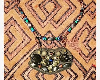 The MINI SHIELD NECKLACE by Gilded-Mane: Antique Brass Tulips on Olive Leather, Small
