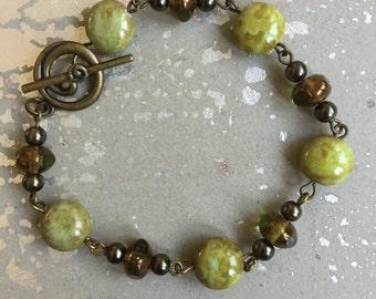 Bronze and green bracelet.