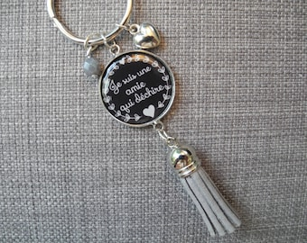 "Keychain Silver ""I'm a friend who rocks"" with tassel, bead and charm."