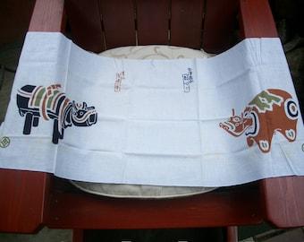 "Japanese Tenugui Cotton Hand Towel ""Kibi Gyu And Akabeko."""