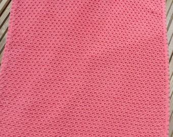 Pink machine knitted pram blanket