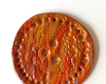 Very large handmade button, sunset orange