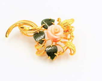 Vintage gold tone brooch with coral rose and jade leaves