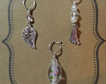 Set of 3 knitting stitch markers in silver tones.