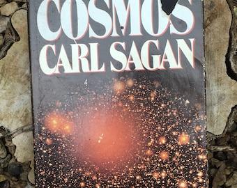 Cosmos by Carl Sagan.  First Edition.