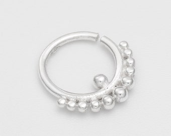 Tribal tragus piercing. cartilage earring. tragus earring. tragus hoops. tiny hoops. tiny earrings. helix earring.piercing