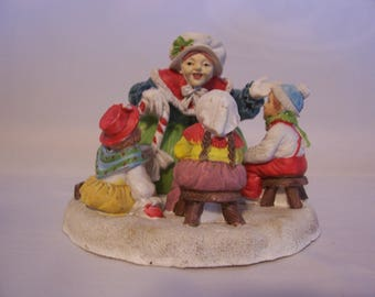 Woman Telling Stories To Children Figurine by Mann
