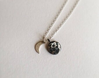 Moon phase charm necklace in sterling silver and oxidised silver on a fine chain