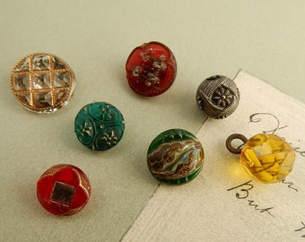 7 Antique Diminutive Glass Charmstring Buttons   NDK23