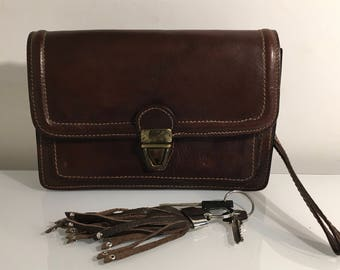 Vintage brown leather small size wristlet