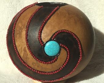 Cannon ball gourd art piece