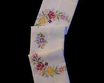 Vintage cross-stitched tablecloth or table topper -- white topper with hand-cross-stitched flowers -- 30.5x30 inches / 77.5x76 cm