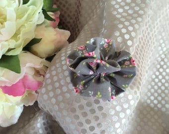 flower in gray fabric with pink flowers