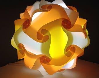 Light yellow, orange and white lamp sphere puzzle