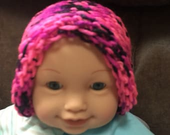 Pink and black knit baby hat