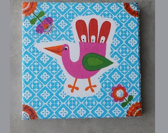 Canvas with art decoupage with a pink bird for a child's room