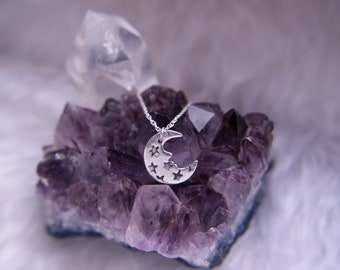 Sterling silver moon face necklace, stars & crescent moon flush set cubic zirconia pendant