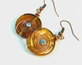 Amber Glass Earrings,  Round with Copper Wrapped  Coil and Turquoise Crystal Accent