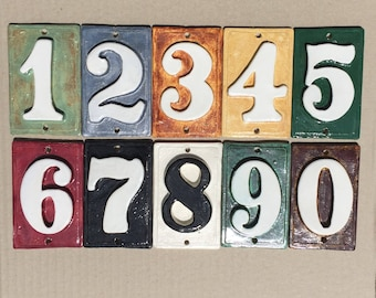 """Narrow numbers for Apartment, Condo, Hotel or Home. 2 5/8"""" x 4 1/2"""" tall. Made with or without holes. Fadeproof weatherproof ceramic glazes."""