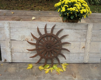 rusty vintage rotary hoe cast iron agriculural cultivater discmetal garden decoryard