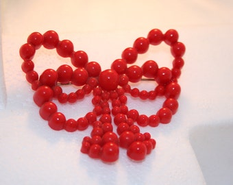 Red bow pin.